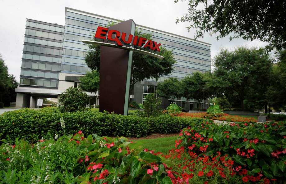 "Equifax is headquartered in Atlanta. Its CEO says that the company's senior leadership team will forgo ""incentive compensation"" - essentially, bonuses - for 2017. About 145.5 million consumers were affected by a data breach at the credit monitoring company.  Photo: Mike Stewart, STF / Copyright 2017 The Associated Press. All rights reserved."