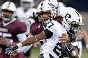 Lee's Isaiah Nunez (36) tackles Odessa Permian's Ed Williams (27) on Nov. 10, 2017, at Grande Communications Stadium. James Durbin/Reporter-Telegram