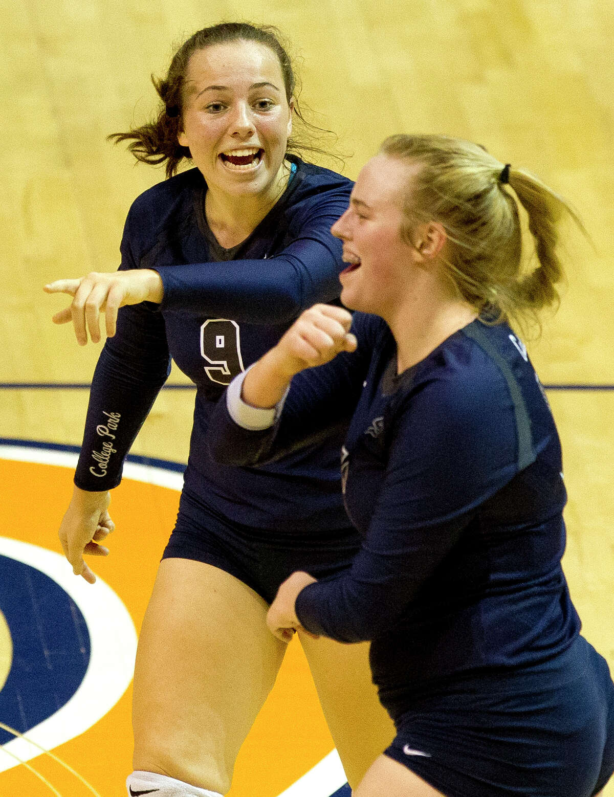 College Park right side hitter Annie Cooke (16) celebrates a point along side Park setter Mackenzie Nunes (9) during the first set of a Region II-6A semifinal match at Johnson Coliseum, Friday, Nov. 10, 2017, in Huntsville.