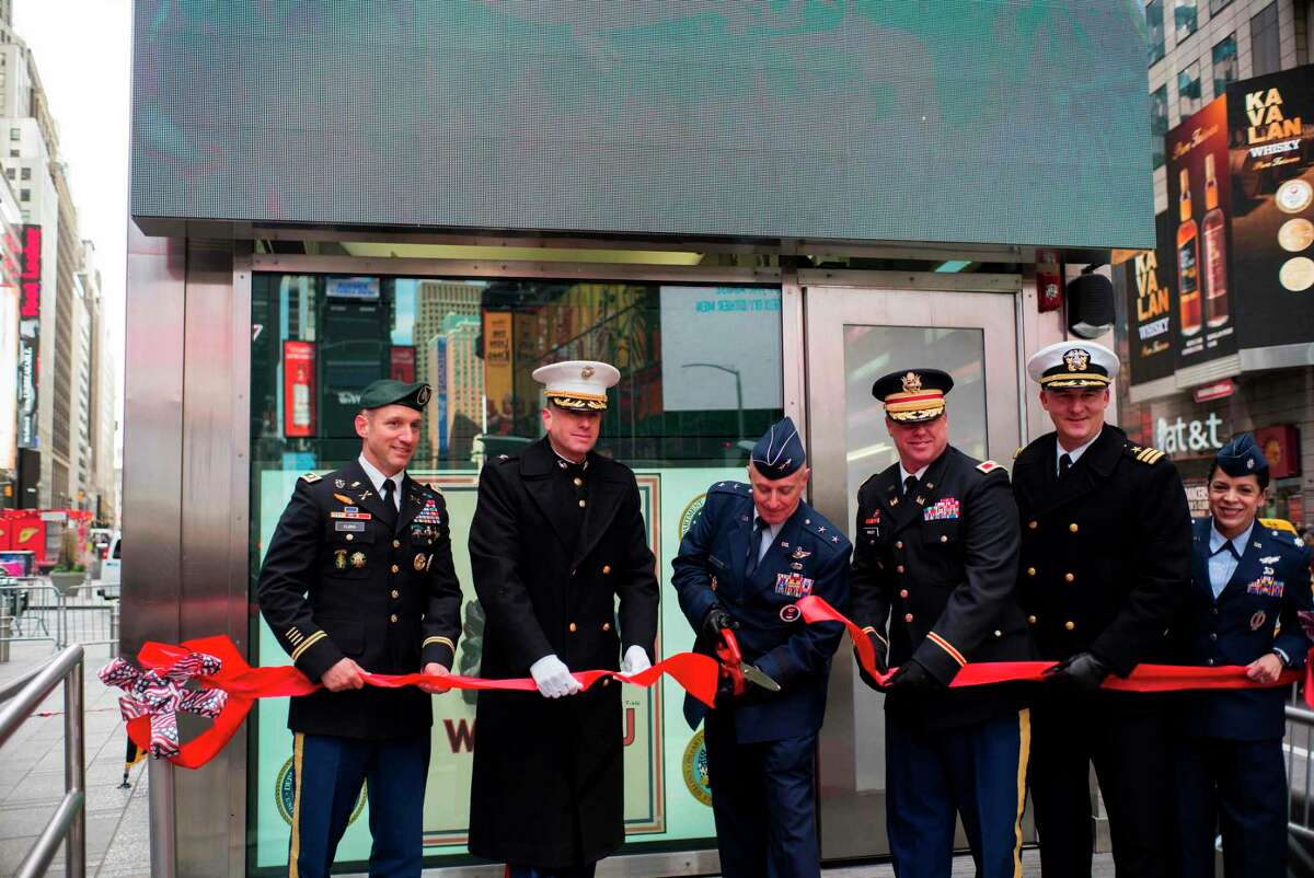 US Air Force Recruiting Service Commander Major General Garrett Harencak (C) cuts a ribbon to reopen the renovated Times Square Recruiting Station in New York on November 10, 2017. / AFP PHOTO / Jewel SAMADJEWEL SAMAD/AFP/Getty Images
