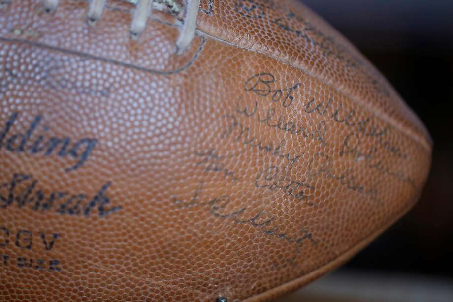 Robert Wilhelm's signature is seen with others on a football signed by the Cal Bears team. Wilhelm is the last living member of the last Cal team to win a Rose Bowl. Photo: Lea Suzuki, The Chronicle