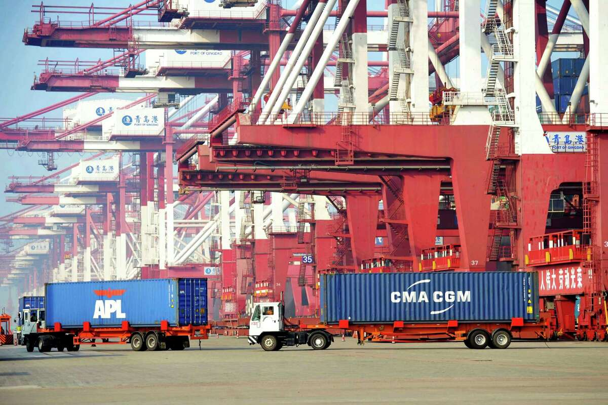 Trucks move shipping containers in Qingdao, in eastern China's Shandong Province. President Donald Trump has targeted some of the sizable trade deficits that the U.S. runs with individual countries. But many economists say a country's trade deficit with individual nations is a pointless measure.