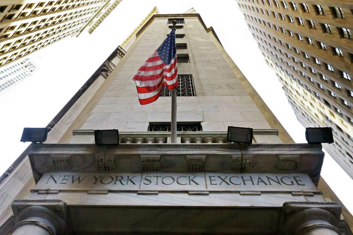 FILE - In this Friday, Nov. 13, 2015, file photo, the American flag flies above the Wall Street entrance to the New York Stock Exchange. U.S. stocks are falling Friday, Nov. 10, 2017, as health care companies skid. Stocks have risen for eight weeks in a row, their longest run in almost four years, but that streak is on track to end. (AP Photo/Richard Drew, File)
