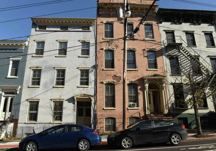 Buildings at 85, left, and 83 Ten Broeck St. on Friday, Nov. 10, 2017 in Albany, N.Y. A Rochester-based developer planning to rehabilitate roughly 70 buildings in Arbor Hill wants an $8 million reduction in taxes over 30 years to help the $47 million affordable housing project come to fruition on Clinton Avenue and Ten Broeck St. (Lori Van Buren / Times Union)' Photo: Lori Van Buren / 20042110A
