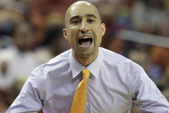 FILE - In this Tuesday, Dec. 27, 2016 file photo, Texas coach Shaka Smart calls to his players during the first half on an NCAA college basketball game against Kent State in Austin, Texas. Texas' freshman class should help the Longhorns rebound from a dismal 2016-17 campaign. Texas' incoming recruiting class was ranked sixth in the 247Sports Composite and features 6-11 forward Mohamed Bamba, the nation's No. 3 overall recruit. Freshman Matt Coleman could take over immediately as the Longhorns' top point guard. (AP Photo/Eric Gay, File)
