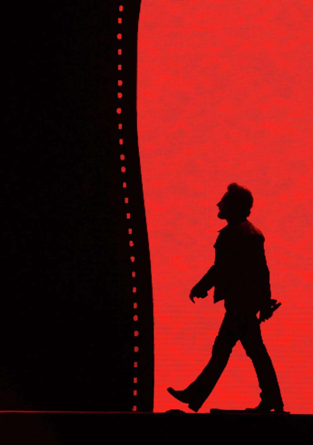 Bono walks downstage as U2 performs at CenturyLink Field, during their 'The Joshua Tree Tour 2017', Sunday, May 14, 2017. (Genna Martin, seattlepi.com)