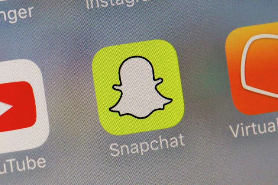 This Wednesday, Aug. 9, 2017, photo shows the Snapchat app. Snap Inc. reports earnings, Tuesday, Nov. 7, 2017. (AP Photo/Richard Drew) Photo: Richard Drew, STF / AP