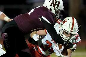 North Haven's Steven Erbe tackles Fairfield Prep's Justin Keith on Friday at Vanacore Field in North Haven.