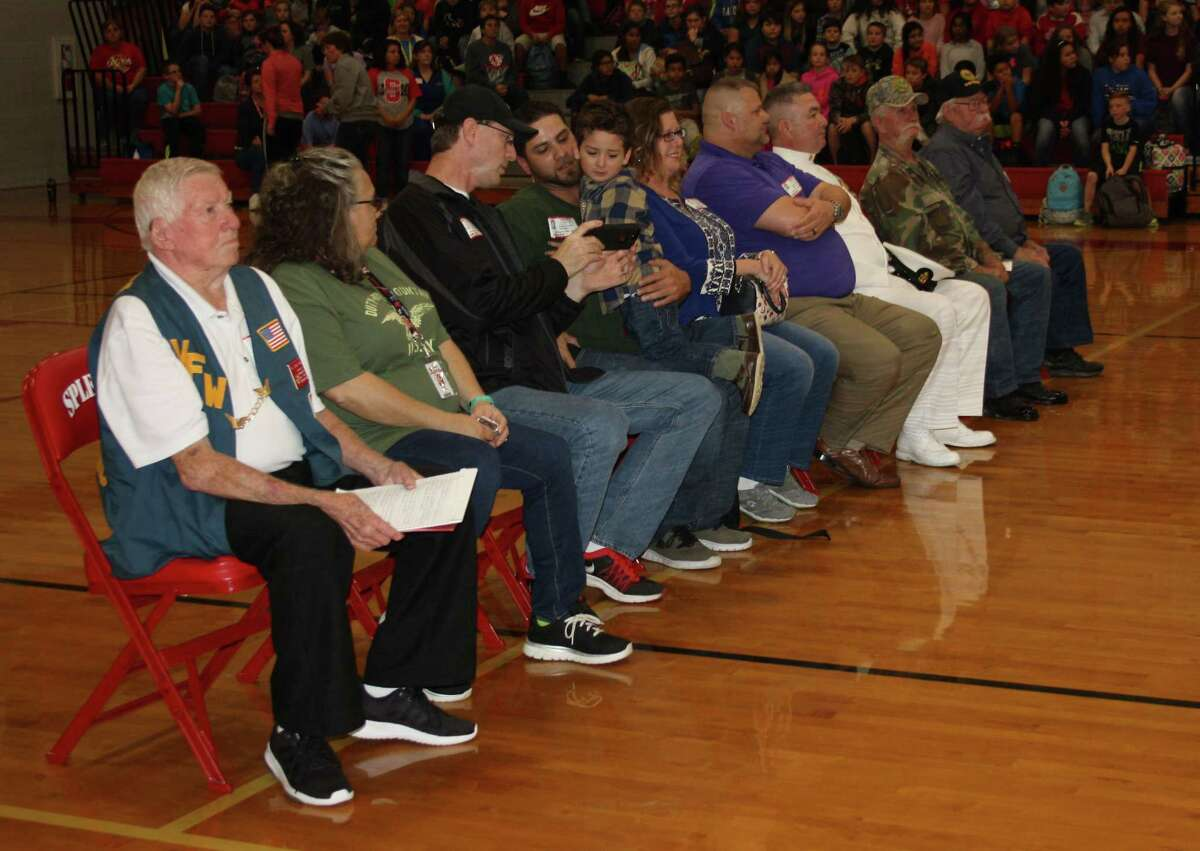 Veterans from U.S. military branches sit in a place of honor in the middle of the Splendora Junior High gym on Friday. The group was honored during a special Veterans Day ceremony.
