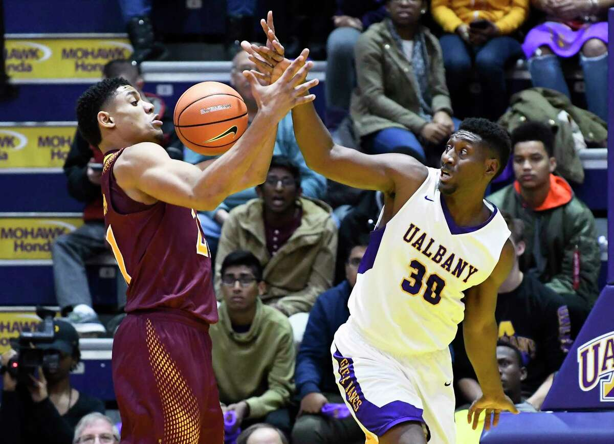 Iona Gaels forward Gavin Kensmil (21) and Albany Great Danes forward Travis Charles (30) battle for a loose ball during the first half of an NCAA men's college basketball game on Friday, Nov. 10, 2017, in Albany, N.Y. (Hans Pennink / Special to the Times Union) ORG XMIT: HP101