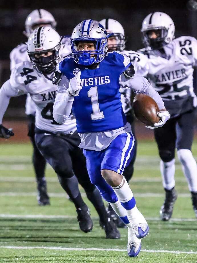 West Haven's Chris Chance (1) slips past Xavier defenders on Friday night. Photo: John Vanacore / For Hearst Connecticut Media / (C)John H.Vanacore/for Hearst Connecticut Media