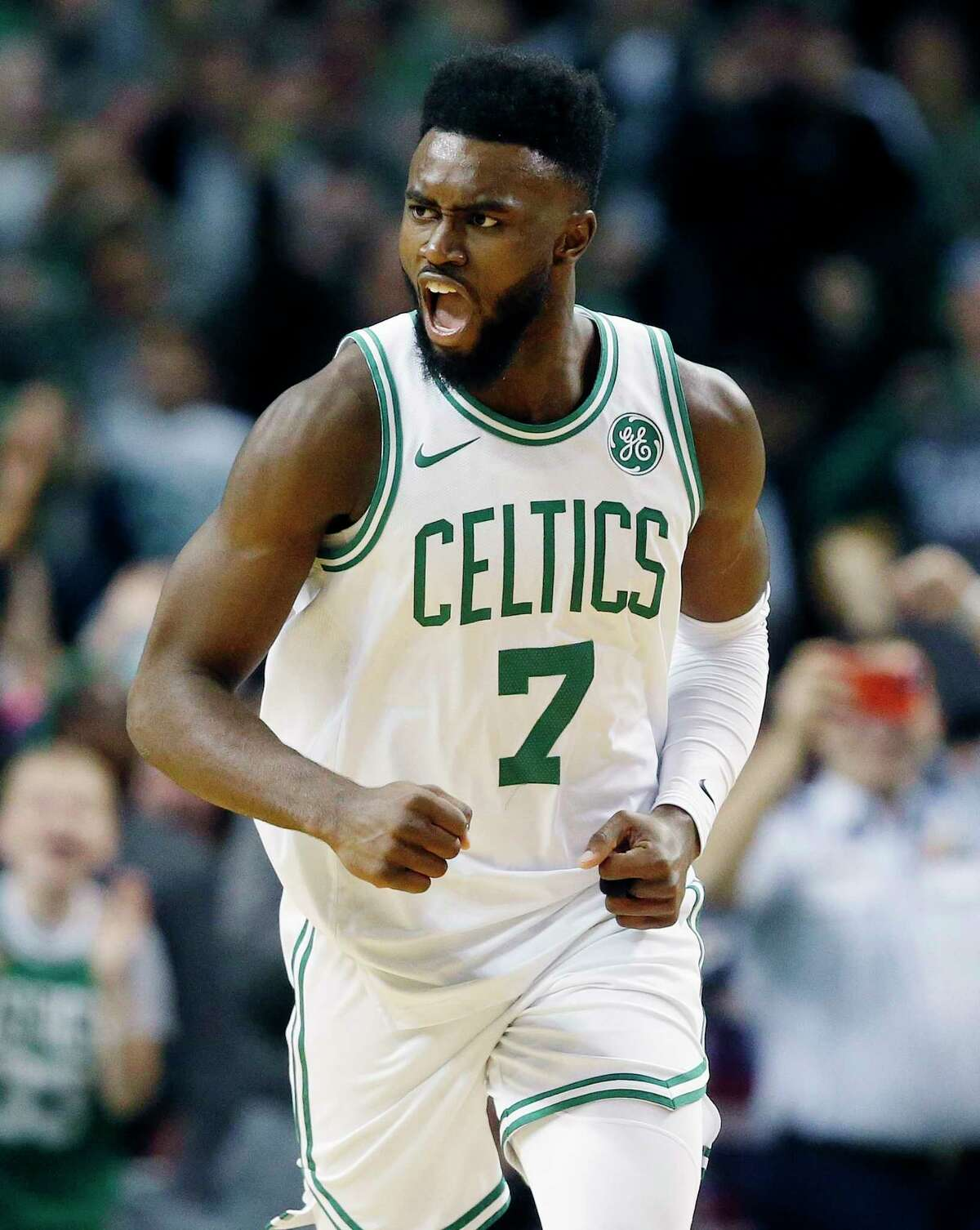 Boston Celtics' Jaylen Brown (7) reacts after scoring during the fourth quarter of an NBA basketball game against the Charlotte Hornets in Boston, Friday, Nov. 10, 2017. (AP Photo/Michael Dwyer) ORG XMIT: MAMD109