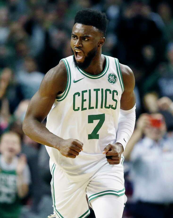 Boston Celtics' Jaylen Brown (7) reacts after scoring during the fourth quarter of an NBA basketball game against the Charlotte Hornets in Boston, Friday, Nov. 10, 2017. (AP Photo/Michael Dwyer) ORG XMIT: MAMD109 Photo: Michael Dwyer / AP2017
