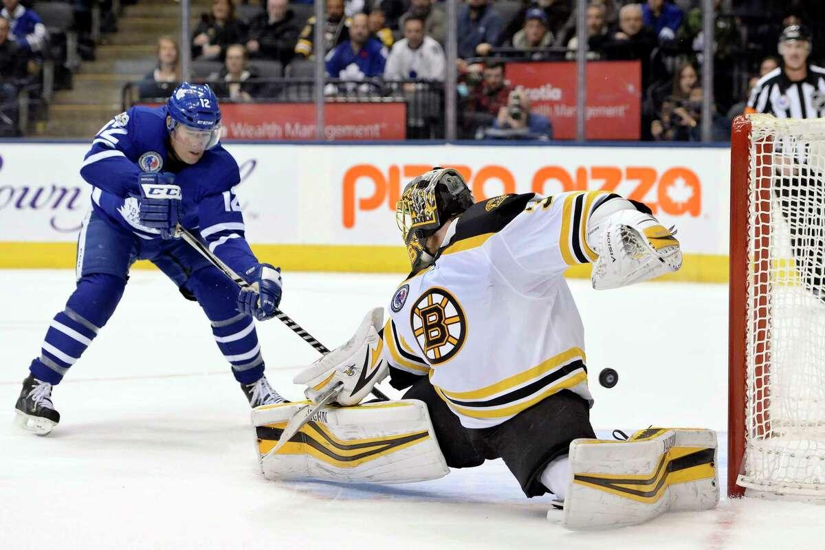 Toronto Maple Leafs center Patrick Marleau (12) scores past Boston Bruins goalie Anton Khudobin (35) during overtime in an NHL hockey game in Toronto, Friday, Nov. 10, 2017. (Nathan Denette/The Canadian Press via AP) ORG XMIT: NSD537