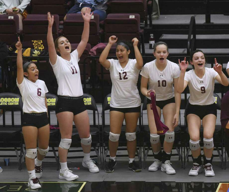 Devine players, from left, Julie Ortiz, Amanda Richardson, Sara Moreno, Megan Runyan and Caimee Fowler encourage their teammates as they fall to Needville in UIL Region IV-4A volleyball playoffs action at Littleton Gym on Friday, Nov. 10, 2017. Photo: Billy Calzada, Staff