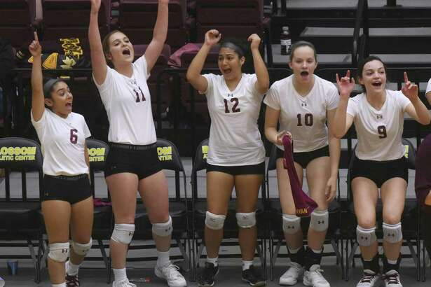 Devine players, from left, Julie Ortiz, Amanda Richardson, Sara Moreno, Megan Runyan and Caimee Fowler encourage their teammates as they fall to Needville in UIL Region IV-4A volleyball playoffs action at Littleton Gym on Friday, Nov. 10, 2017.