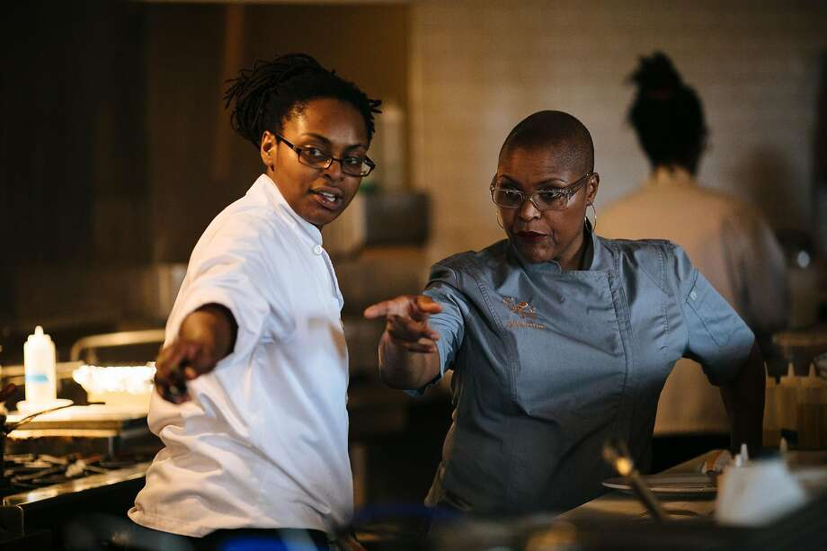 Tanya Holland, right, directs one her staff, LaKeha Pursley, to take an order at her restaurant, Brown Sugar Kitchen, in Oakland, Calif. Friday, November 10, 2017. Photo: Mason Trinca / Special To The Chronicle 2017