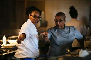 Tanya Holland, right, directs one her staff, LaKeha Pursley, to take an order at her restaurant, Brown Sugar Kitchen, in Oakland, Calif. Friday, November 10, 2017.