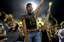 Nederland fans cheer during the Mid-County Madness rivalry game against Port Neches-Groves at Bulldog Stadium on Friday night.  Photo taken Friday 11/10/17 Ryan Pelham/The Enterprise