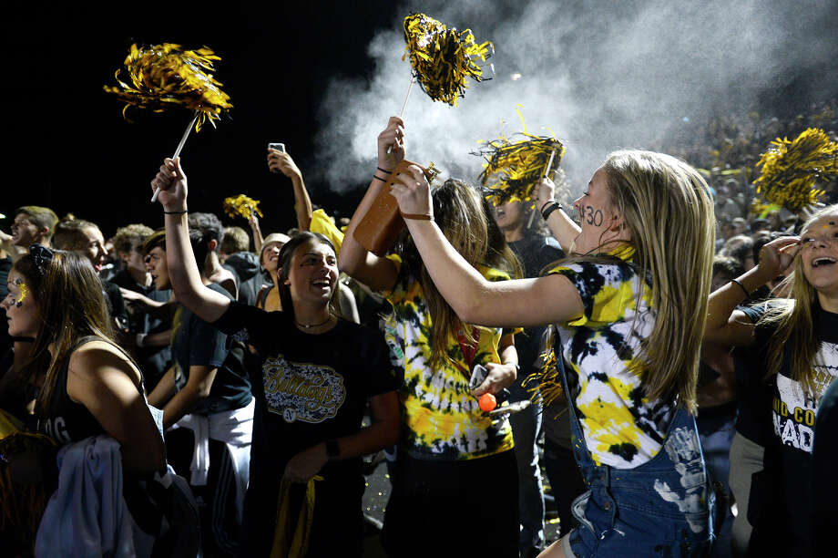 Nederland students celebrate after winning the Mid-County Madness rivalry game against Port Neches-Groves at Bulldog Stadium on Friday night. Nederland won 36-35.  Photo taken Friday 11/10/17 Ryan Pelham/The Enterprise Photo: Ryan Pelham / ©2017 The Beaumont Enterprise/Ryan Pelham