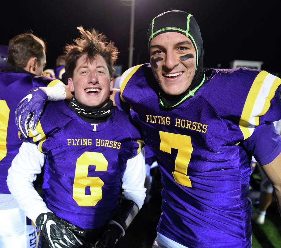 Troy High kicker #6 Mike Fazio, left, and his holder, QB #7 Joe Casale are all smiles after their Class AA quarterfinal win against New Rochelle Friday Nov. 10, 2017 in East Greenbush, NY.  (John Carl D'Annibale / Times Union) Photo: John Carl D'Annibale / 20042086A