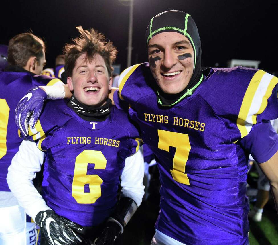 Troy High kicker #6 Mike Fazio, left, and his holder, QB #7 Joe Casale are all smiles after their Class AA quarterfinal win against New Rochelle Friday Nov. 10, 2017 in East Greenbush, NY. (John Carl D'Annibale / Times Union)