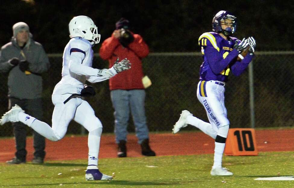 Troy's #11 Isaiah Burdette out runs New Rochelle defender #2 Romeo Holden, left, to catch a touchdown pass during their Class AA quarterfinal game Friday Nov. 10, 2017 in East Greenbush, NY. (John Carl D'Annibale / Times Union)
