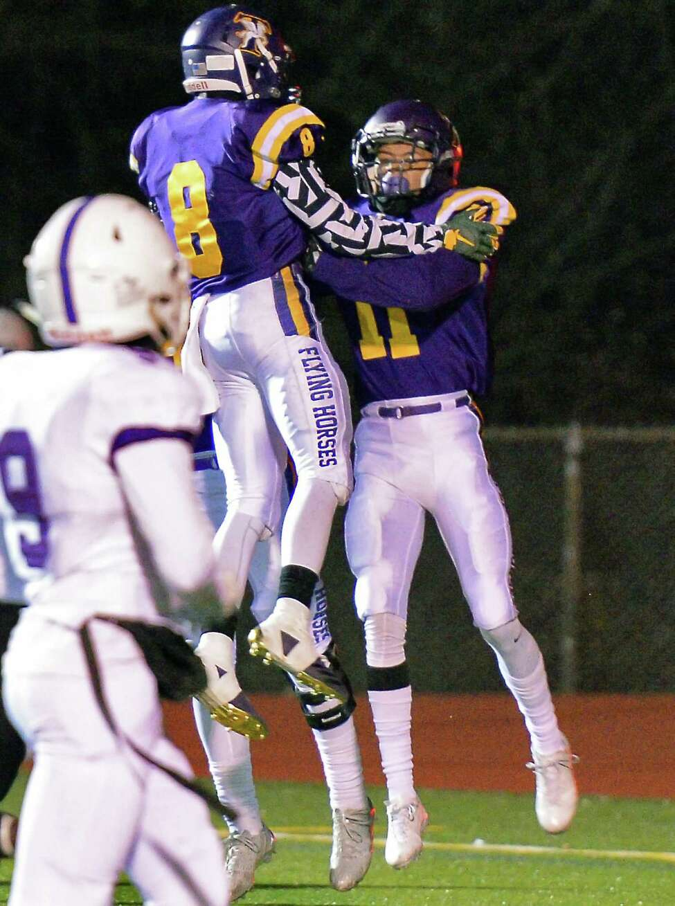 Troy's #11 Isaiah Burdette, right, is congratulated by team mate Dev Holmes after Burdette's touchdown pass completion during their Class AA quarterfinal game against New Rochelle Friday Nov. 10, 2017 in East Greenbush, NY. (John Carl D'Annibale / Times Union)