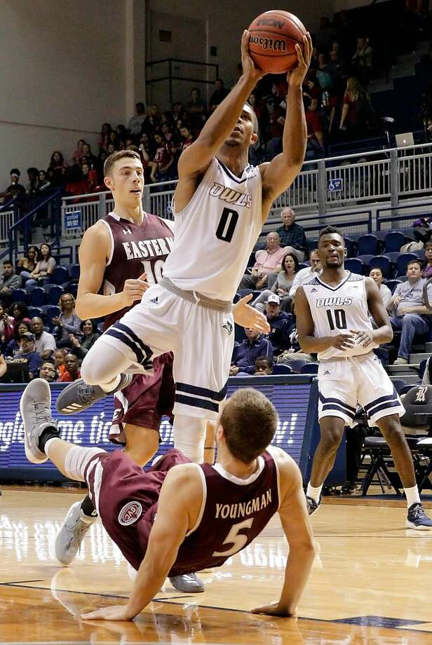 Rice Owls guard Connor Cashaw (0) shoots in front of Eastern Kentucky Colonels forward Nick Mayo (10) as Eastern Kentucky Colonels guard A.J. Youngman (5) falls backward in the second half of their game, Nov. 10, 2017, in Houston, TX. (Michael Wyke / For the  Chronicle) Photo: Michael Wyke/For The Chronicle