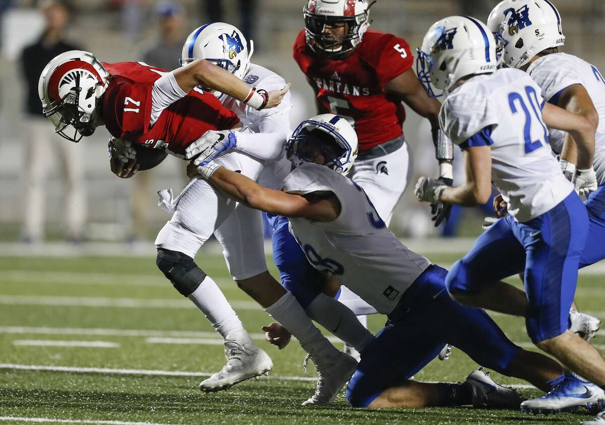 Porter quarterback Zane Russell (17) is tackled by Barbers Hill's Branden Heffernan (8) and Brady Bonnin (38) during the first half of a 21-5A high school football game at Texan Drive Stadium on Friday, Nov. 10, 2017, in Houston. ( Brett Coomer / Houston Chronicle )
