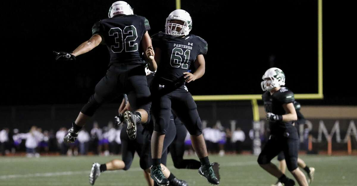 Kingwood Park Panthers running back Desmond Benjamin (32) celebrates with Kingwood Park Panthers Cj Sims (61) after a first half touchdown during the high school football game between the Humble Wildcats and the Kingwood Park Panthers in Humble, TX on Friday, November 10, 2017.