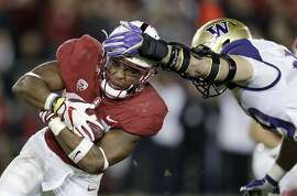 Stanford running back Bryce Love, left, carries as Washington linebacker Connor O'Brien attempts to tackle him during the first half of an NCAA college football game Friday, Nov. 10, 2017, in Stanford, Calif. (AP Photo/Marcio Jose Sanchez)