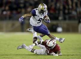 Washington running back Myles Gaskin (9) leaps over Stanford cornerback Quenton Meeks during the first half of an NCAA college football game Friday, Nov. 10, 2017, in Stanford, Calif. (AP Photo/Marcio Jose Sanchez)