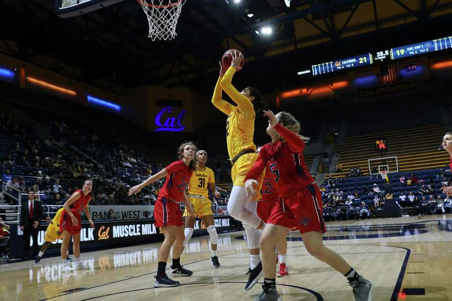 The California Golden Bears women's basketball team played the Saint Mary's Gaels at Haas Pavilion in Berkeley, Calif on Friday Never 10, 2017.  Cal Forward Penina Davison (#12) got sup for a basket. She ended with 10 pts, 12 rebounds in Cal's 87-80 victory. Photo: Please Courtesy KLC Fotos / Please courtesy KLC Fotos