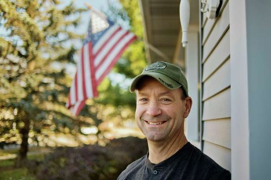 Midland resident Richard Glumm, a veteran of both the U.S. Army and Marine Corps, poses for a portrait in front of his home on Friday. Glumm served as a Marine for six years and another 18 as a soldier before retiring from the Army in 2011 as sergeant first class. (Katy Kildee/kkildee@mdn.net)
