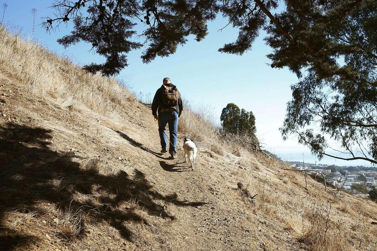 Alex Aldrich walks his dog, Concha, in McLaren Park.