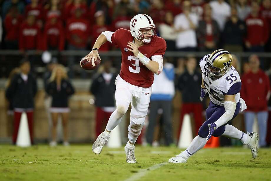 PALO ALTO, CA - NOVEMBER 10:  K.J. Costello #3 of the Stanford Cardinal is pressured by Ryan Bowman #55 of the Washington Huskies at Stanford Stadium on November 10, 2017 in Palo Alto, California.  (Photo by Ezra Shaw/Getty Images) Photo: Ezra Shaw, Getty Images