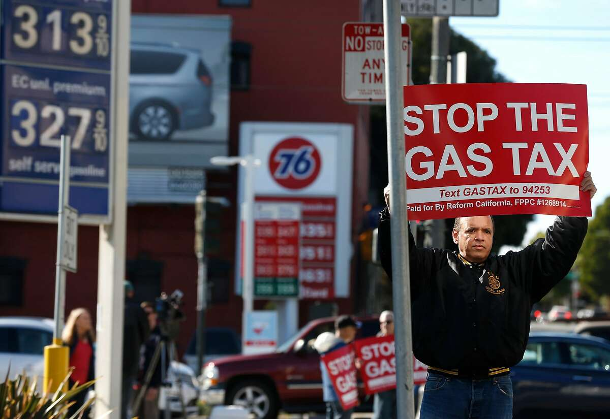 Anthony Ballester joins about a dozen demonstrators in a protest against the statewide 12-cents per gallon gas tax in front of the Arco station at Fell and Divisadero streets in San Francisco, Calif. on Saturday, Nov. 4, 2017.