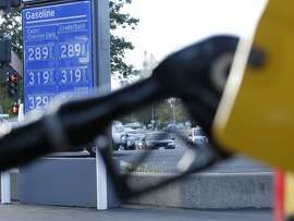 In this photo taken Monday, Oct. 30, 2017, gasoline prices are displayed at a Chevron station in Sacramento, Calif. Gasoline taxes will rise by 12 cents per gallon Wednesday, Nov., 1, to raise money for fixing roads and highways. It is the first of several tax and fee hikes that will take effect after they were approved by the Legislature earlier this year. (AP Photo/Rich Pedroncelli)