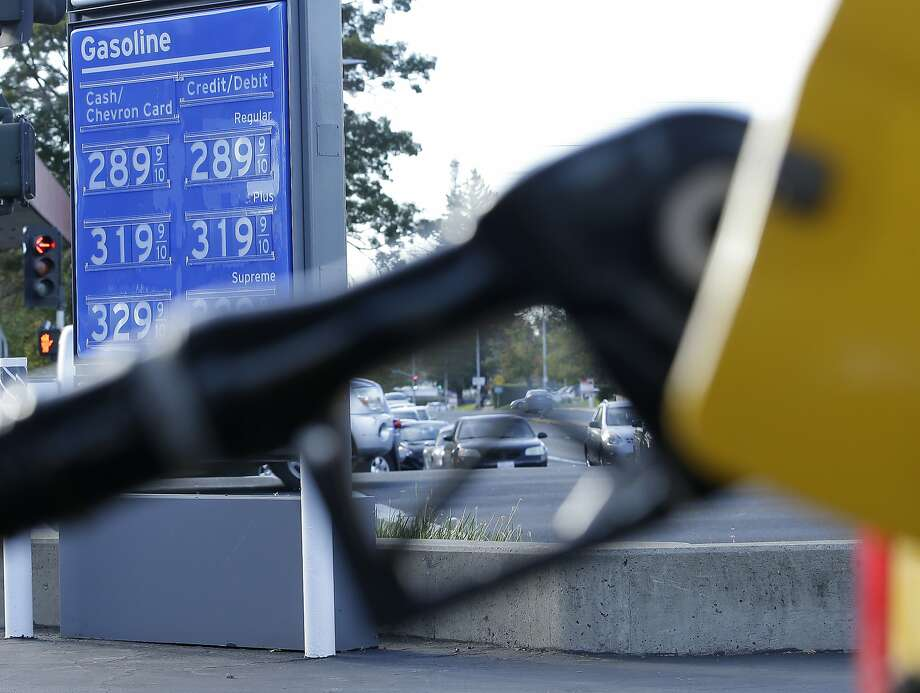 In this photo taken Monday, Oct. 30, 2017, gasoline prices are displayed at a Chevron station in Sacramento, Calif. Gasoline taxes will rise by 12 cents per gallon Wednesday, Nov., 1, to raise money for fixing roads and highways. It is the first of several tax and fee hikes that will take effect after they were approved by the Legislature earlier this year. (AP Photo/Rich Pedroncelli) Photo: Rich Pedroncelli, Associated Press