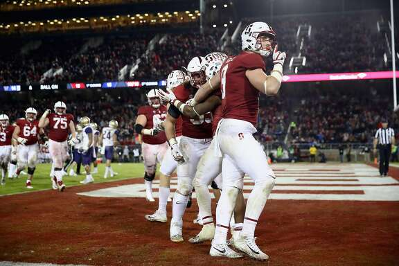 PALO ALTO, CA - NOVEMBER 10:  Dalton Schultz #9 of the Stanford Cardinal gestures for the Washington Huskies fans to be quiet after Bryce Love #20 of the Stanford Cardinal scored a touchdown at Stanford Stadium on November 10, 2017 in Palo Alto, California.  (Photo by Ezra Shaw/Getty Images)