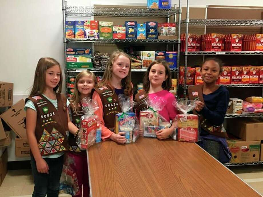 To honor the Oct. 31 birthday of Girl Scouts founder Juliette Gordon Low, Brownie Troop 50834 assembled and donated birthday kits to the HELP Food Pantry at Memorial Presbyterian Church. (Photo provided)