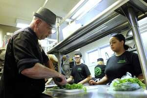 File photo of Chef-instructor Blythe Roberts demonstrates the proper way to cut cilantro for Lindsay Carter Wednesday, Sept. 27, 2017 at the Culinary School of Northwest Conn. The non-profit school operates out of St. John's Church in New Milford.