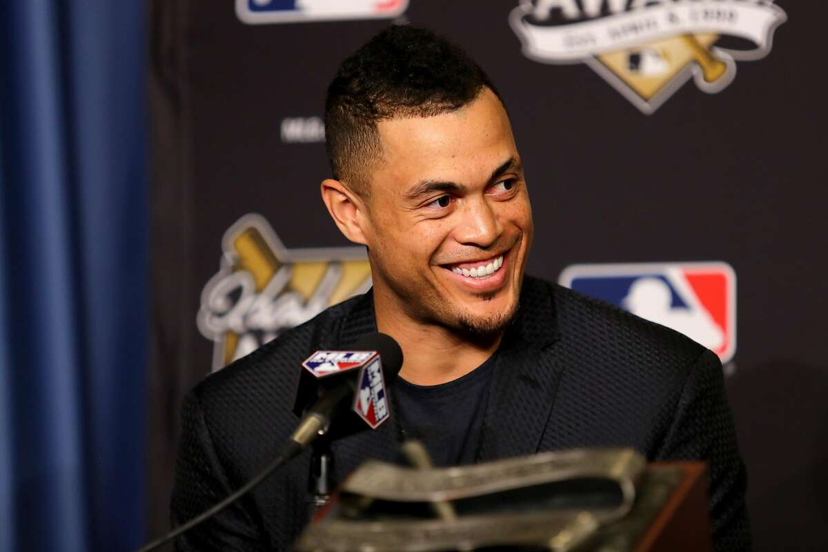 LOS ANGELES, CA - OCTOBER 25: 2017 Hank Aaron Award recipient Giancarlo Stanton #27 of the Miami Marlins attends the 2017 Hank Aaron Award press conference prior to game two of the 2017 World Series between the Houston Astros and the Los Angeles Dodgers at Dodger Stadium on October 25, 2017 in Los Angeles, California. (Photo by Tim Bradbury/Getty Images)