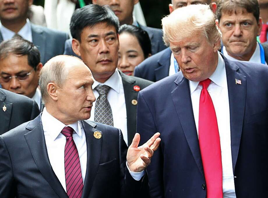 Russian President Vladimir Putin visits with President Trump at the Asia Pacific Economic Cooperation summit meeting in Danang, Vietnam. Photo: Mikhail Klimentyev, Associated Press
