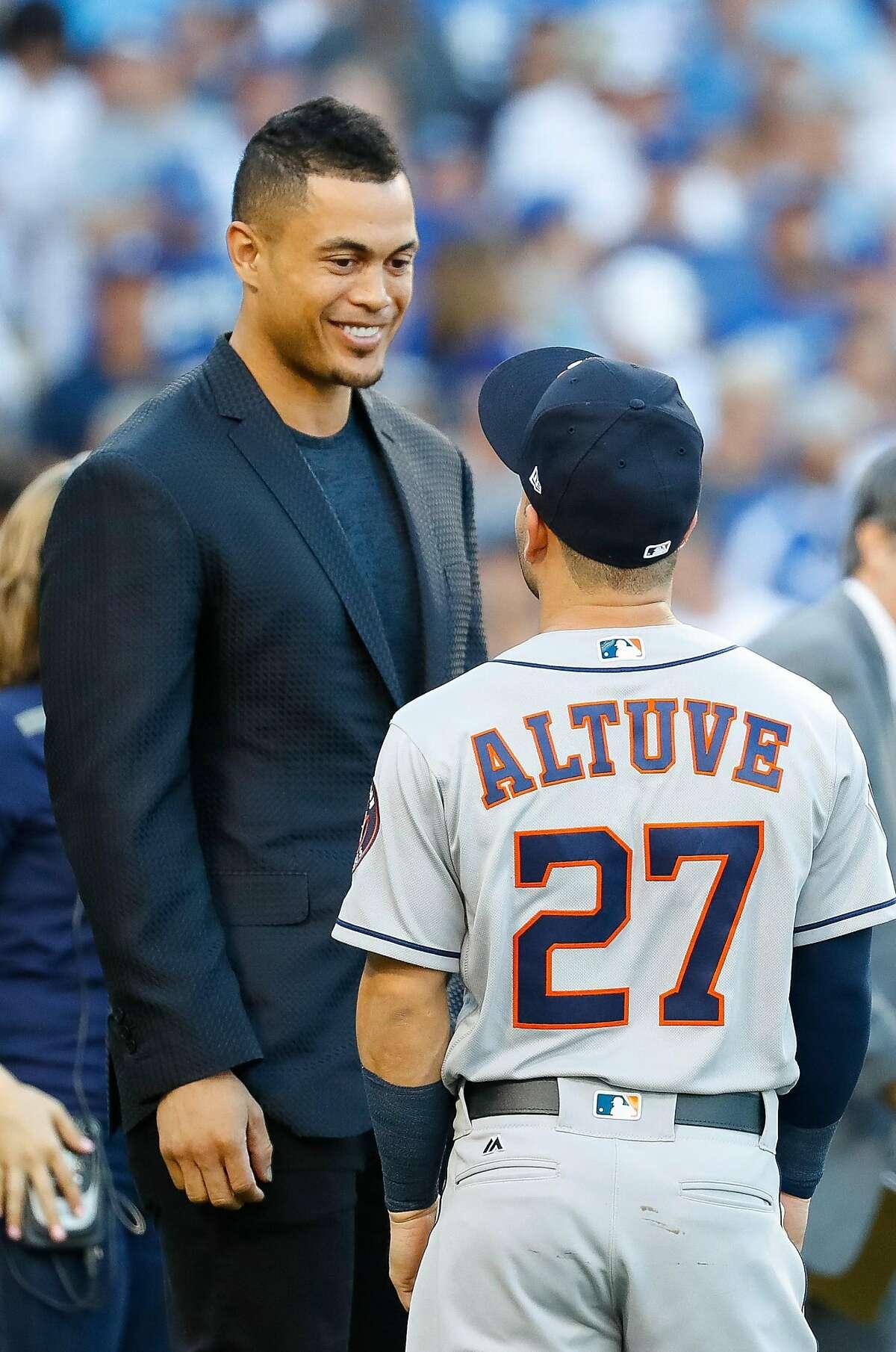 Hank Aaron Award winners Jose Altuve and Giancarlo Stanton talk before Game 2 of the World Series at Dodger Stadium on Wednesday, Oct. 25, 2017, in Los Angeles. ( Karen Warren / Houston Chronicle )