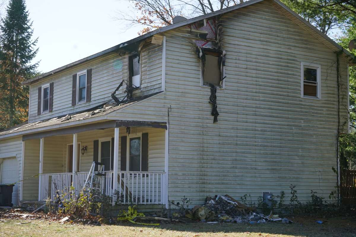 A Clifton Park home at 2 Merion Ave. has damage the day after a fire that claimed a man's life on Nov. 10, 2017. (Massarah Mikati/Times Union)