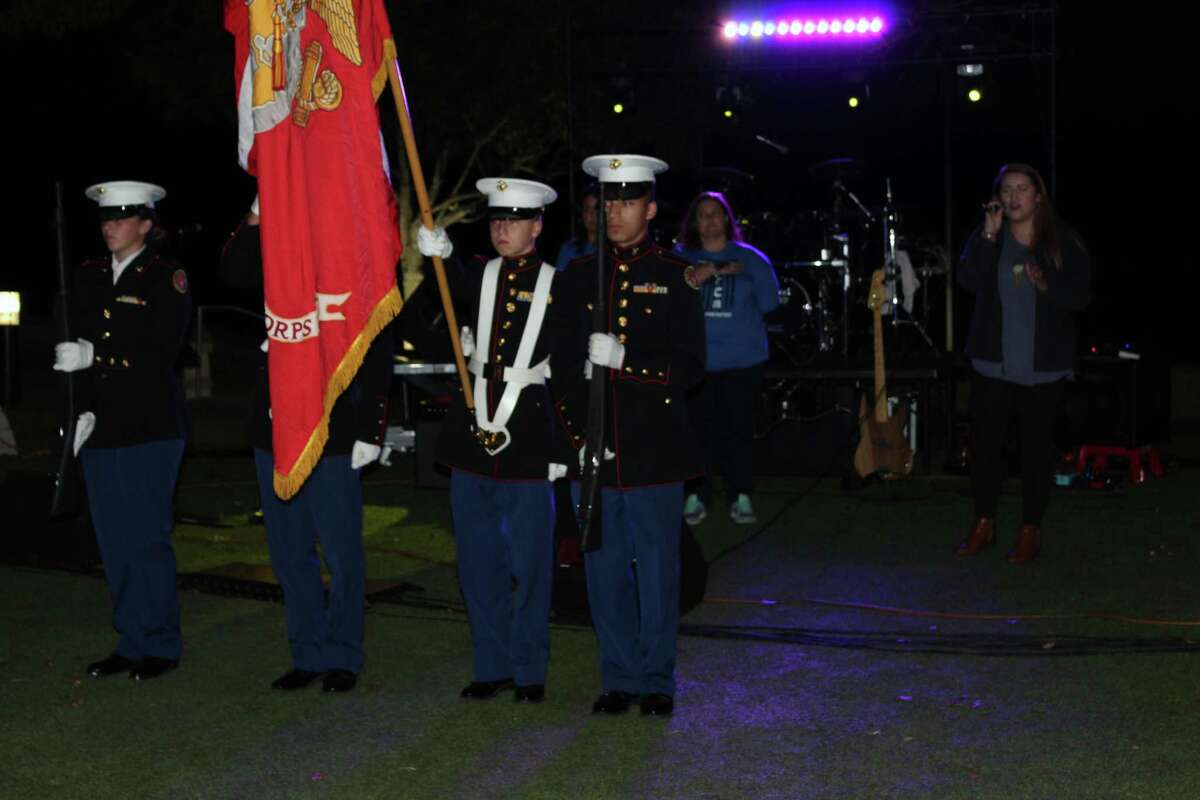 The Atascocita High School JROTC present the colors during the National Anthem at Turn Kings Harbor Blue in Kingwood on Friday, Nov. 10.