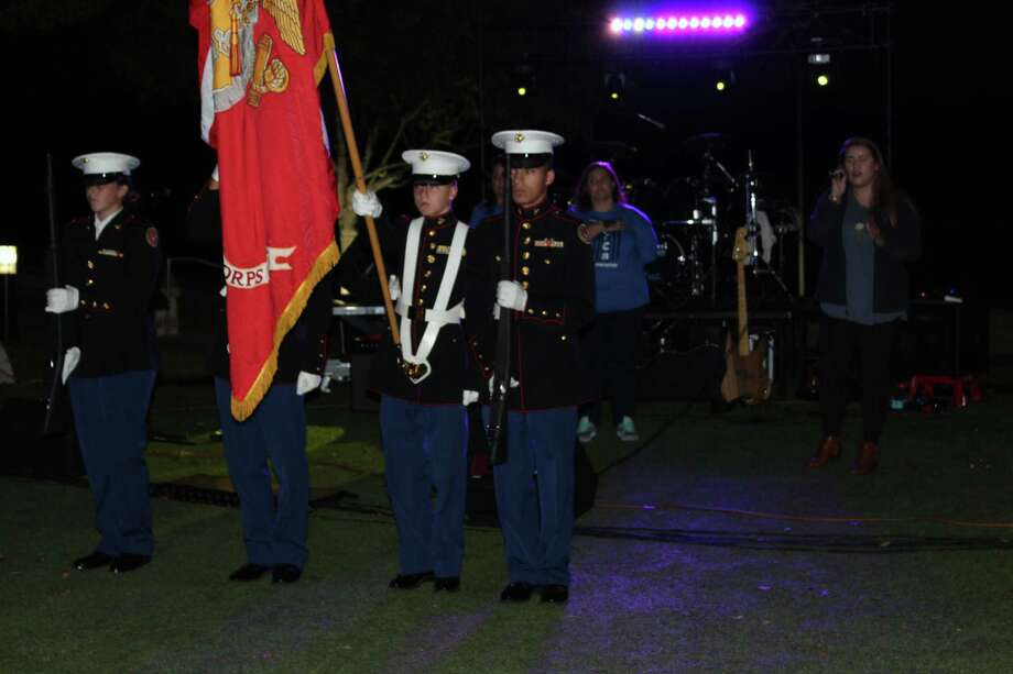 The Atascocita High School JROTC present the colors during the National Anthem at Turn Kings Harbor Blue in Kingwood on Friday, Nov. 10. Photo: Melanie Feuk