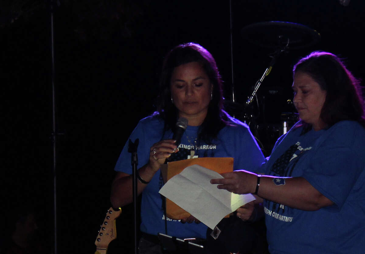 Joseph Chris Partners' CEO Veronica Ramirez reads a letter of appreciation sent by President George Bush during Turn Kings Harbor Blue in Kingwood on Friday, Nov. 10.